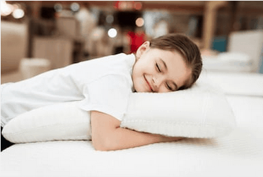 girl hugging pillow