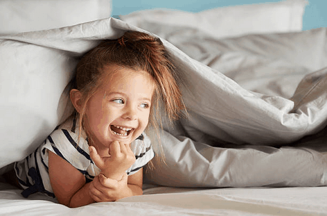 Happy kid on natural bed