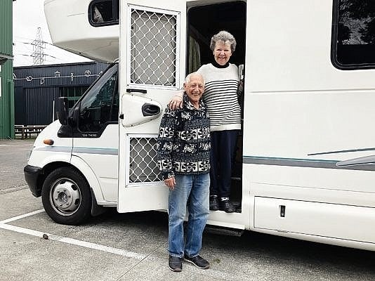 happy motorhome couple
