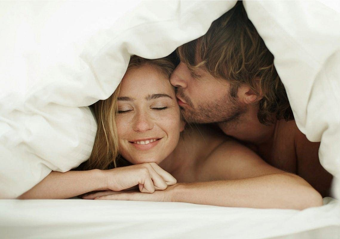 Happy couple on natural bed
