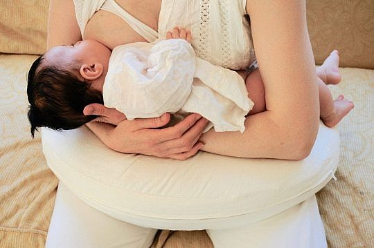 breastfeeding pillow and baby